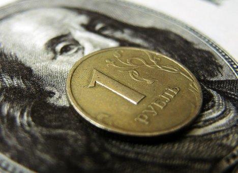 Нефть увлекла рубль за собой